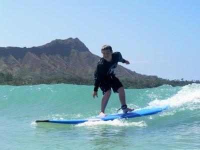 Surfing in front of Oahu's Diamond Head, Waikiki Beach, Hawaii (photo by Waikiki Beach Services)