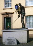 Statue of President Clinton Golfing in Ireland