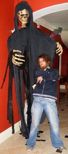 halloween decorations - huge skeleton grabbing the Bean