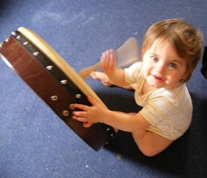 munchkin playing the bodhran