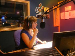 June Carley, midlands 103 DJ interviewing kerbside