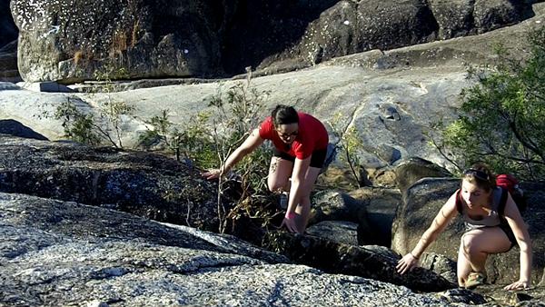 climbing over rocks